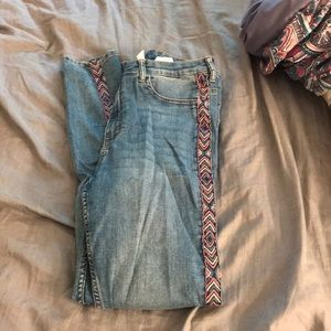 H&M jeans with designs on the side